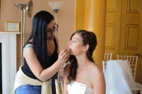 MUA Ria Masih, applies the finishing touches to Amys makeup
