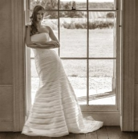Amy wears our Broadway wedding gown